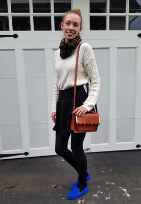 The author, Amanda Wright, showing how to wear a chunky knit sweater, patterned scarf, mini skirt, and bold colored shoes