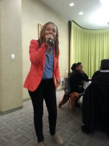 The poet Decipher delivers an emotional performance at The Black Student Union's Cafe Night