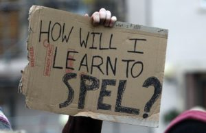 A sign a protester created for an occupation at England's Bristol University in response to budget cuts and proposed tuition increases. Photo by Matt Cardy for Getty Images. Image obtained through Britannica ImageQuest.