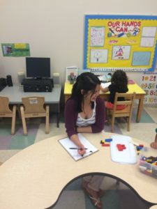 Alyssa Tejada working in the day care. (Photo by Kasey LaRue.)