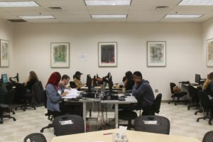 Students focus on math assignments in one the CAP's labs. Photo taken by reporter.