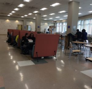 Housatonic students enjoying downtime with their friends in the Lafayette cafeteria.  (Photo by author)