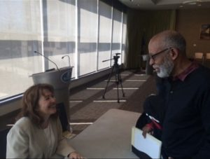 McBride speaking with Professor Aubrey Moncrieffe. (Photo by the author.)