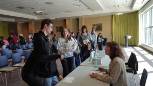 HCC students and staff wait with copy in hand. (Photo by the author.)