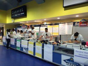 Volunteers prepare sign-in areas.( Photo by Kerri Lloyd)