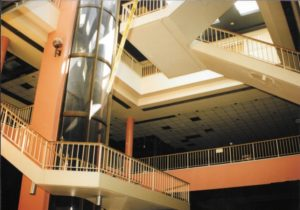 Glass elevator inside old shopping mall of Lafayette Hall. Photo by Eleanor C. Winkel from the Presidents Archive of Housatonic Community College.