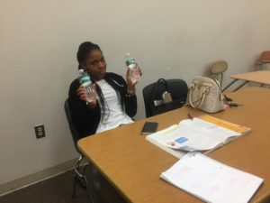Student doubling up on her water during class. (Photo by the author)