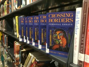 Available copies of 'Crossing Borders' in the HCC Library. Photo By Eric Vazquez.
