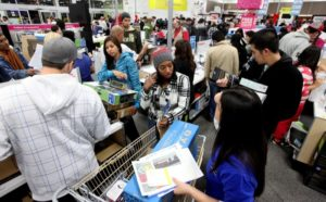 Customers shop for electronics items during 'Black Friday' at a Best Buy store on November 25, 2011 in San Diego, California. (Photo by Sandy Huffaker/Getty Images) Used by permission of Brittanica ImageQuest.