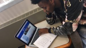 Soon to be graduated student Rashard Brewer researching and noting the proper steps he will need to take in order to successfully apply to become a transfer student at the University of Delaware. Photo by Gianni Sapienza.